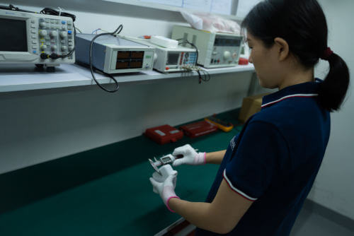 Inspector measuring product during pre-shipment inspection