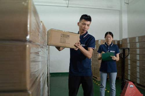 Inspectors pulling cartons for a pre-shipment inspection